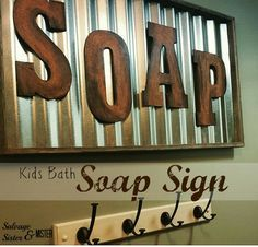 A DIY Corrugated metal and salvaged wood SOAP sign for bathroom.  Great reminder for the kids to wash up. www.salvagesisterandmister.com