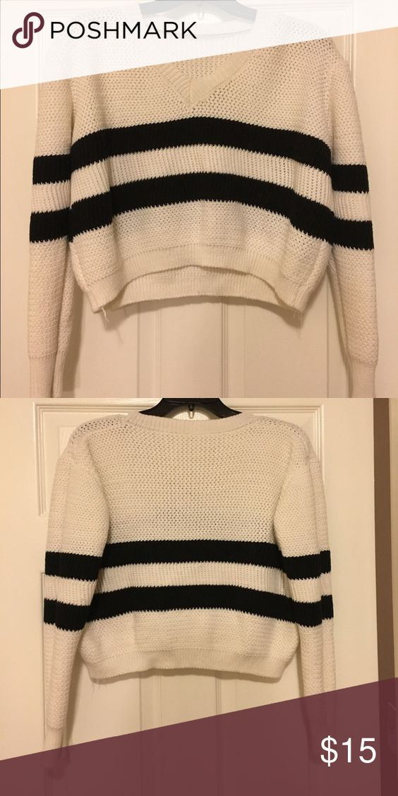 Cropped white sweater with black stripes This sweater is a v neck and cropped just enough for high waisted jeans. Very comfy and cozy Sweaters V-Necks