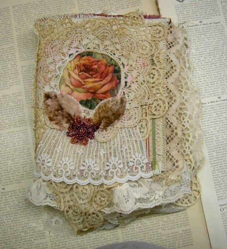 This is an exquisite one of a kind shabby chic fabric and lace album.  It measures 6 x 8 inches x 2 1/2  inches thick and contains twelve gorgeous interactive pages.  I've stuffed it with tons of  hei