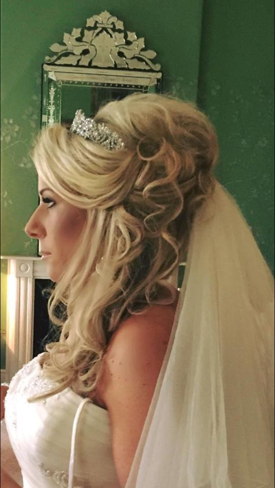 Wedding hair, extensions used to create dramatic volume and curl, hair to the side with tiara and veil