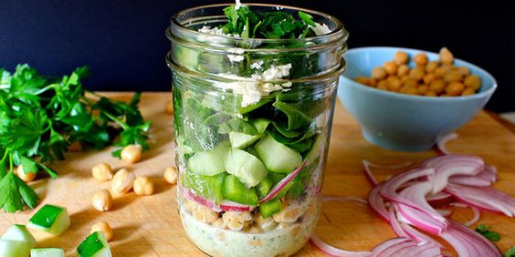 We love the combination of chickpeas, crisp bell pepper, and refreshing cucumber in this Mediterranean Mason jar salad.