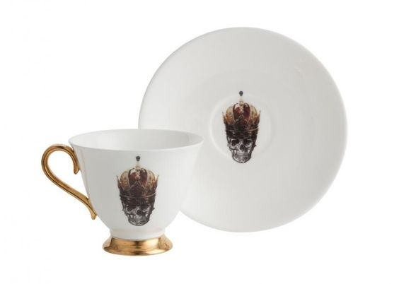 Enjoy a regal cup of tea from this bone china Skull in Red Crown teacup and saucer set. Beautiful and quirky, this bone china teacup and saucer with the 'Skull in Red Crown' design is part of the Melody Rose London Inspired collection. Gorgeous displayed, but also entirely functional and can be used every day. Looks wonderful with the Skull in Crown Teapot but pieces can be bought individually, as sets, or mixed and matched and make wonderful gifts. Made from: Bone china teacup and saucer…