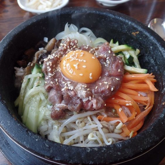 """My favourite cuisine is #KoreanFood I love a good #bibimbap this is a #dolsot or stone bowl bibimbap with raw beef and egg. The bowl is hot when served so the meat and egg cook during mixing. The best bit is to leave it a a few minutes before mixing so you have crispy rice :) yum @iquitsugar #realfood #naturalfood #wholefood #foodpics #foodporn #iquitsugar #lowsugar #diabeticfriendly #glutenfree #wheatfree #justeatrealfood #fuellingthisflankerlady #IQS8WP #IQSJERF #JERF #IQS #paleo…"