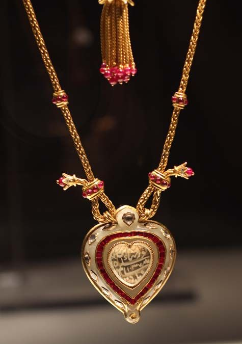 The Taj Mahal Diamond / ELIZABETH TAYLOR'S JEWELRY COLLECTION   The Taj Mahal Diamond with gold and ruby chain by Cartier - Circa 1627 - The heart shaped diamond is inscribed with the name Nur Jahan, wife of Mughal Emperor Shah Jahangir. Richard Burton gave this historical jewel to Elizabeth Taylor for her 40th birthday.