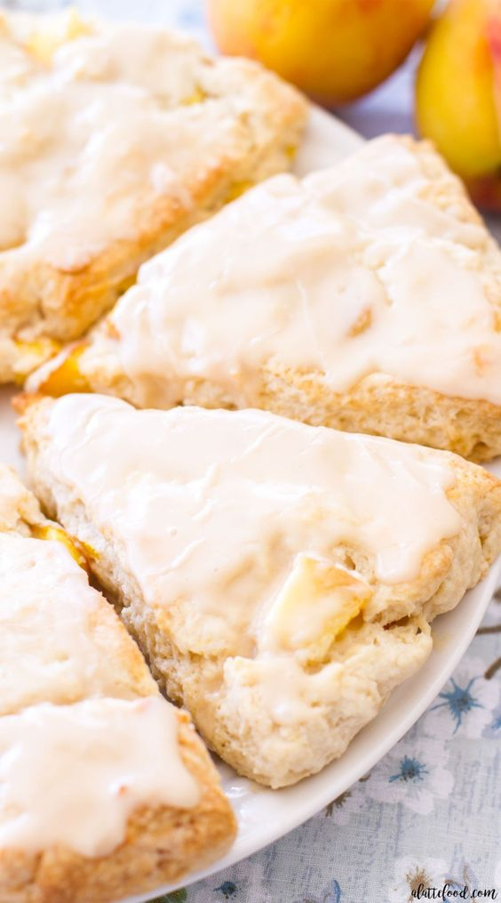 These easy Peach Pie Scones taste just like peach pie! Peaches 'n Cream Scones are the perfect summer breakfast or summer brunch recipe! With their sweet vanilla glaze, these peach cream scones taste like they have a scoop of vanilla ice cream on top!