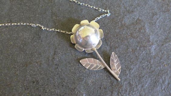 Hollow bead flower pendant made from scraps
