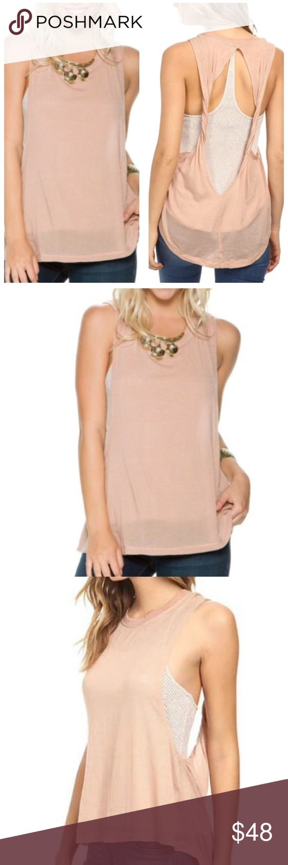 Free People Twist Tank Peach tank with an open, twisted back accent. 57% tencel, 8% modal, 5% spandex; Lining: 60% cotton, 40% polyester. Casual curved hemline. Free People Tops Tank Tops