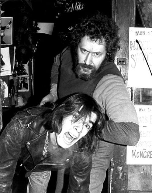 Legs McNeil gets thrown out of CBGB by Hilly Kristal.  Photo by Roberta Bayley.
