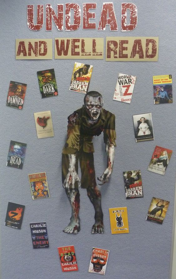 Undead and well read. Zombie library display.  This is literally bloody awesome -- would never go in my school, but I absolutely love this!!: