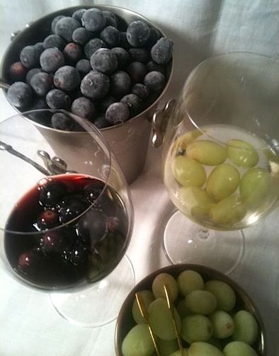 Freeze red grapes for red wine (to cool down to the desired 72 degrees) and green grapes for white wine.  No melty ice!