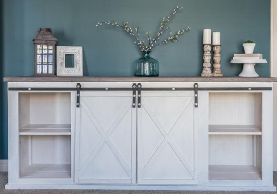 This sliding barn door console table is the perfect addition to your living room, dining room, bedroom or kids toy room. It can also be used