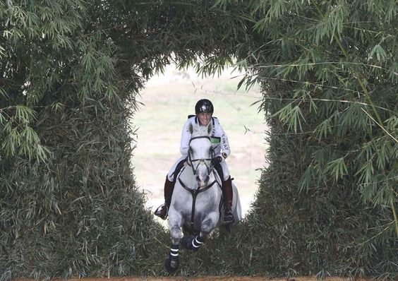 2016 Rio Olympics, Equestrian, Preliminary, Eventing Individual Cross Country, Deodoro Olympic Equestrian Centre, Rio de Janeiro, Brazil on August 8, 2016. Colleen Loach (CAN) of Canada riding Qorry Blue D'argouges jumps through the bamboo keyhole. (Photo by Adrees Latif/Reuters)