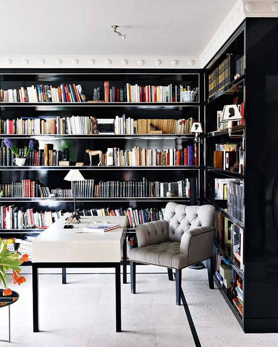 Study with black built in bookshelves.  home office.  home decor and interior decorating ideas.