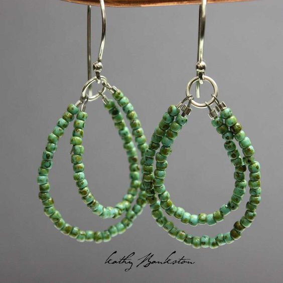 Shiny antiqued turquoise green glass seed bead earrings. This is a very pretty antique turquoise color. Please note these are glass beads, they are not genuine turquoise. These earrings feature too pr                                                                                                                                                     More