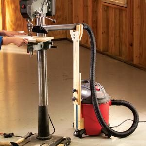 Tired of sawdust covering your workbench and woodworking tools? This adjustable vacuum hose holder attaches to the shop vacuum and can be rolled into position exactly where it's needed.