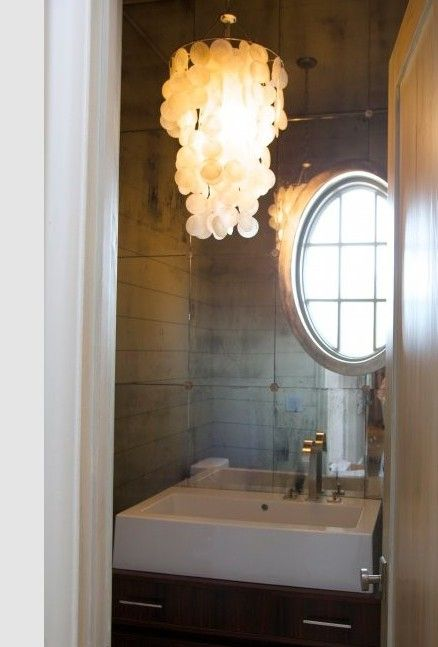 great powder room, small but covered in mirrors
