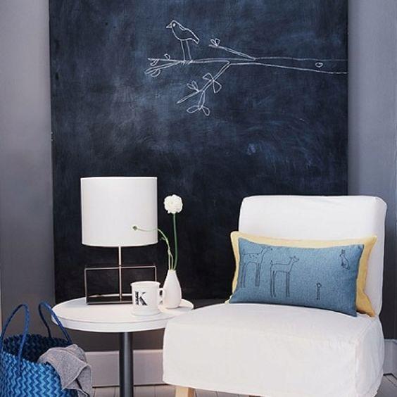 Blackboard and blue cushion.