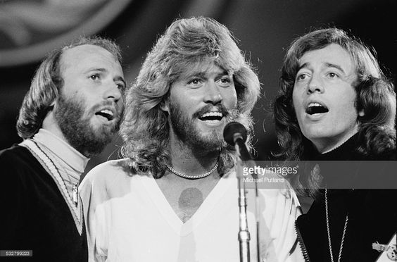 The Bee Gees performing at 'The Music for UNICEF Concert: A Gift of Song' benefit concert held at the United Nations General Assembly in New York City, 9th January 1979. Left to right: Maurice Gibb (1949 - 2003), Barry Gibb and Robin Gibb (1949 - 2012).