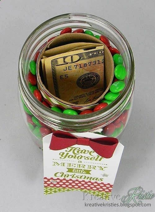 Cover toilet paper roll, adhere and put inside mason jar. Fill around the roll with favorite candy. This is the COOLEST way ever to give money!! Put candy in according to the season or just favorite candy!! .: