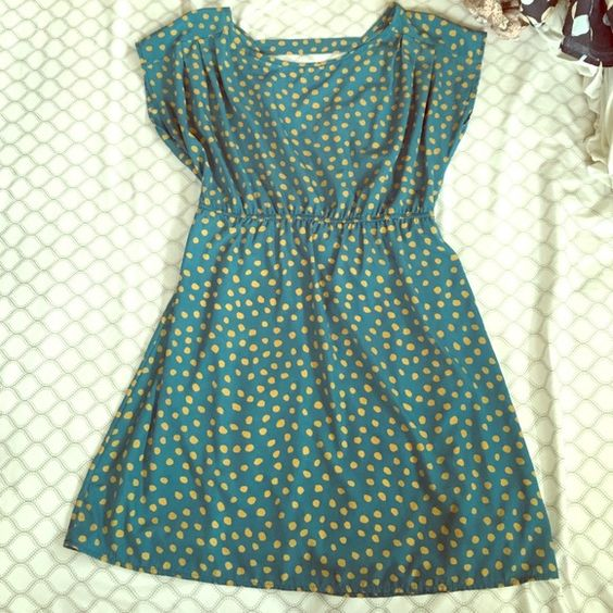 "Teal and mustard polka dot dress Adorable boutique style teal and mustard polka dot dress perfect for summer! Has a open ""v"" shaped back and a strap across top and cute pleat details on shoulders. Peaches and cream brand size small. Has lining in skirt portion and dress hits just about the knee. Dresses"