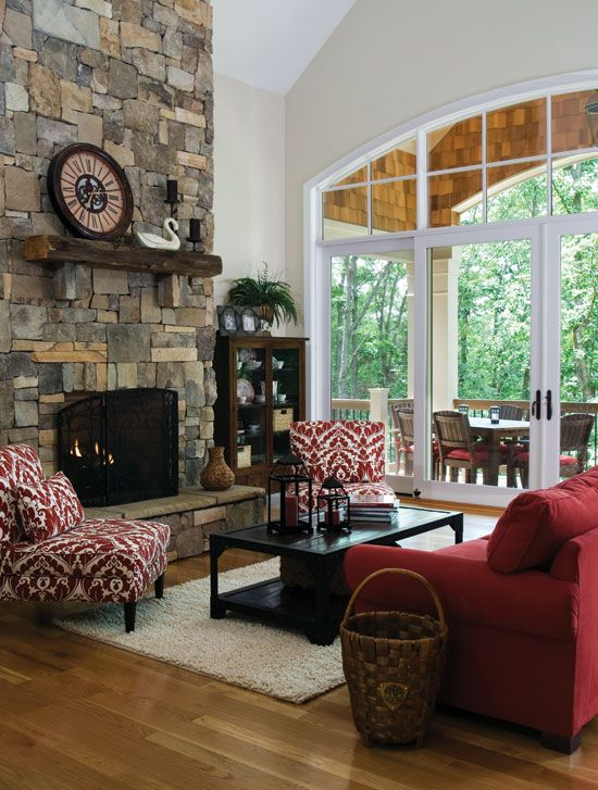 Pantone Color of the Year: Marsala. Red upholstery ties this great room and covered porch together, and draws out the natural vibrancy of the stone fireplace and cedar shake in this mountain home. http://houseplansblog.dongardner.com/pantone-color-year-marsala/