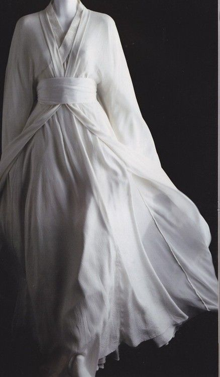 -Though it was only plain white, the fabric billowed out like a handkerchief, and for half a moment she thought the woman might blow away.:
