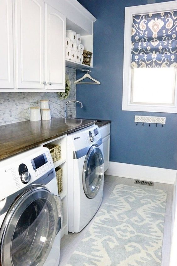 In order to save floor space and make room for working comfortably in the room, use the wall space creatively by hanging hooks on the walls. #laundryroom #Laundryroomideas #smalllaundryroom #laundry