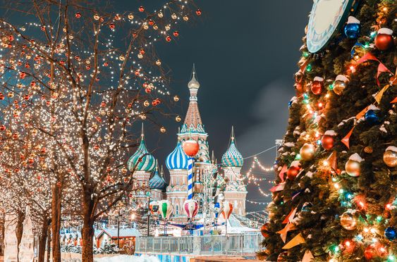 Decorations for New Year and holidays. Christmas balls on tree branches near to St. Basil's Cathedral on Red Square in Moscow