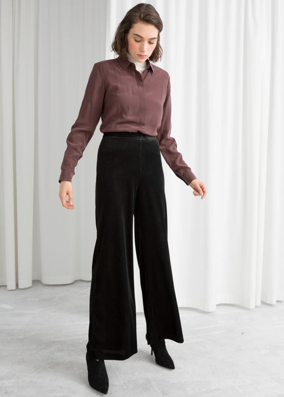 Model front image of Stories flared velour trousers in black