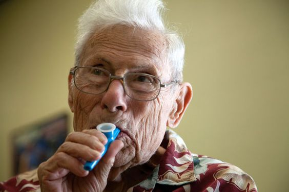 Victor Trivett, 88, plays on his blue kazoo. The instrument is used to help regulate the breathing of people with Parkinsons. Trivett was a ballroom dancer and a disk jockey for over thrity years, which ended when he began to manifest the symptoms of Parkinson's disease over a year and a half ago. Now, his caretaker, Trudy Milone, 71, comes with him to music and dance therapy classess at the church. Cayla Nimmo // Photo Editor