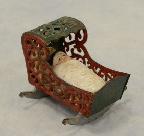 Cast Iron Filigree Hooded Cradle, With CD Kenny