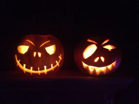 Mine and Scott's carved pumpkins! #halloween #pumpkin designs #pumkin