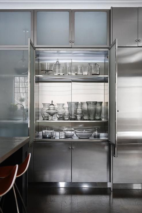 Frosted Glass China Cabinet Doors Open To Stainless Steel Shelves