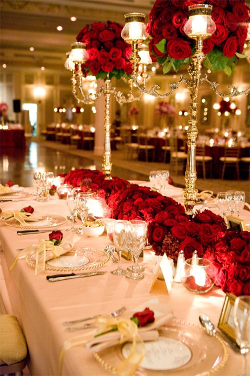 red and gold table settings and decorations I love the red flowers against the white table cloths.: