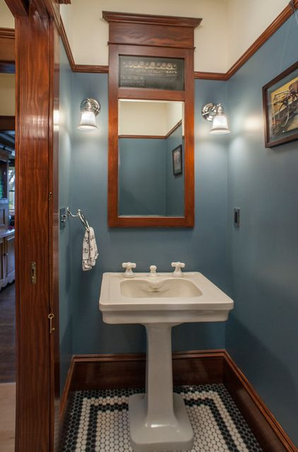 Dark stained wood. Molding and wooden trimwork, mirror surrounds and wooden vanities are all commonplace in Craftsman bathrooms. They go back to that handcrafted quality and use of natural materials.: