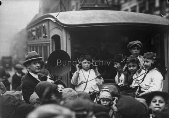 London children at a free radio concert in the street, celebrating the upcoming Christmas, December 1930.