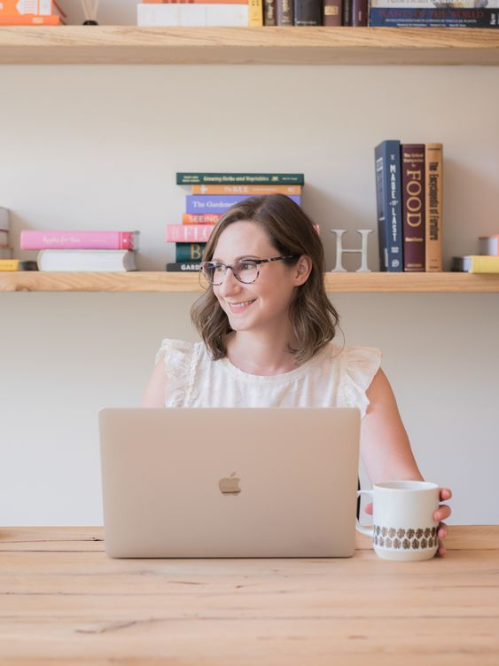 portrait of a graphic designer working at her computer, photographed by jamie bannon photography.