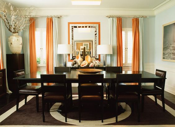 dining rooms - blue walls wainscoting white orange drapes zebra mirror polished chrome lamps espresso leather dining chairs nailhead trim espresso dining table chocolate brown circle rug