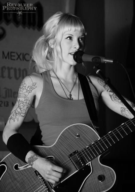 Sarah Blackwood, I don't sing, I dont play any instrument... I just happen to admire her a lot.. how she follows her passion...wanna be like her but with black hair and a paintbrush..and all the tattoos