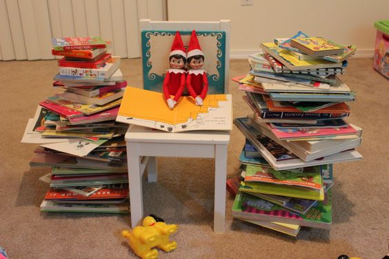 The stack of books to read to the toy friends!