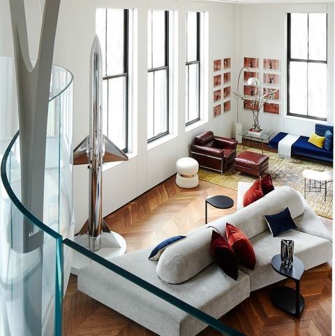 In The Apartment The Lighting Shades Speakers And Heating And Cooling Systems Can All Be Controlled Through An A New York Apartment Custom Sofa Bookshelves
