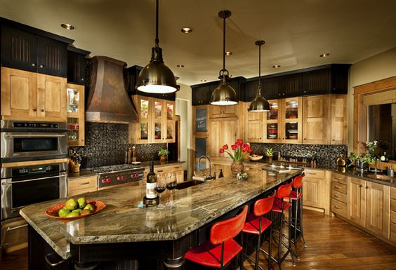 Alder and painted lyptus cabinets, walnut floor, and industrial pendants.