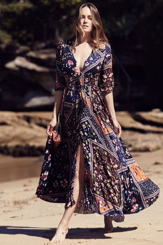 Gorgeous Maxi Dress by Jaase featuring button up 1/2 sleeves, Elastic Waist, Crochet lace detailing on back, Button down front with tie, full length maxi dress