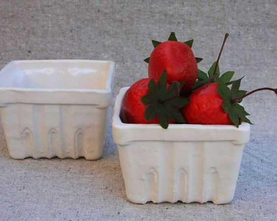 I made a mold of a paper berry basket from the market and made them in stoneware.  I love using them to bake individual berry cobbler.  Berry Basket Bowl 1 in Stoneware with White by gutentagfibers, $12.00