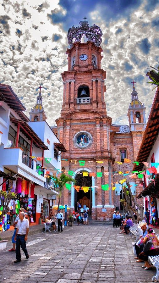 Take a trip to the church of Our Lady of Guadalupe in Puerto Vallarte, Mexico. The iconic landmark dominates the city's skyline and is its most recognzable monument.