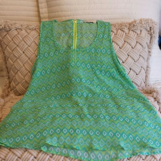 Colorblind sheer zippered back top with 1 front pk Green and neon yellow with neon zipper in back 23 inches long and flowy.100% poly colorblind Tops Blouses
