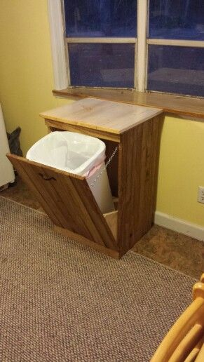 Pallet trash can holder. $7 for harware pallets and ...