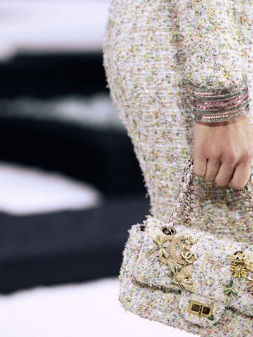 Detail of Chanel bijoux on Emily Senko. Chanel S/S 2011 Show, Paris.