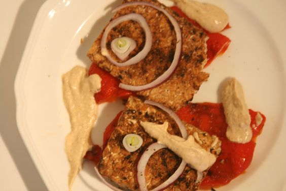 Broiled seitan with roasted red peppers, red onion and remoulade sauce. YES!