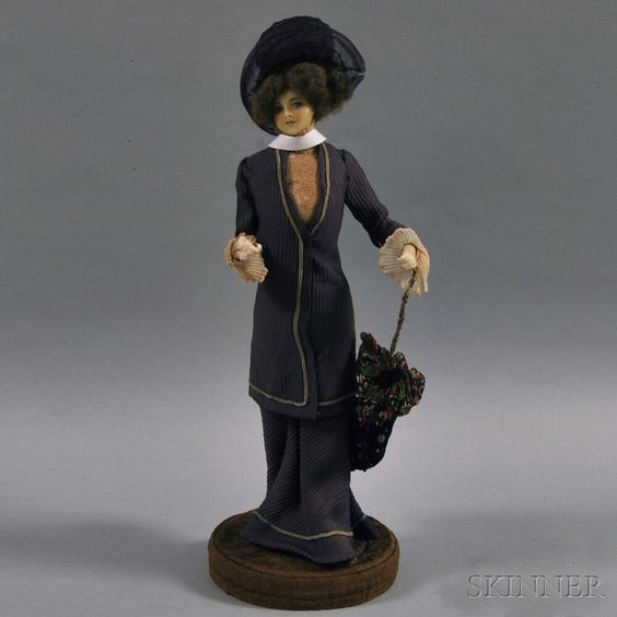 Lafitte-Desirat Wax Fashion Doll, France, c. 1909, standing figure with molded wax face and neck, purple crepe dress, purple net hat, and floral crepe parasol: